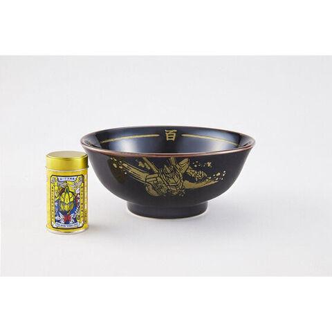 汁を飲み干せばあの名台詞が! 艶やかな黒地に金色のデザインが輝く百式どんぶり&オリジナルデザイン缶のゆず七味がセットで登場!